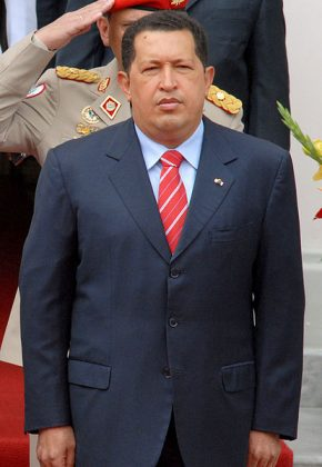 Hugo Chavez standing to attention
